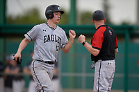 Edgewood Eagles catcher Alex Prindle (15) fist bumps head coach Al Brisack during the second game of a double header against the Bethel Wildcats on March 15, 2019 at Terry Park in Fort Myers, Florida.  Bethel defeated Edgewood 3-2.  (Mike Janes/Four Seam Images)