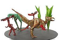 Detail of Origami model.<br /> Compsognathus designed by Richard Galindo Flores, folded by Dan Cohen<br /> Dilophosaurus designed by Juanfran Carillo, folded by Rosalind Joyce<br /> Feathered Velociraptor designed by Saku, folded by Rosalind Joyce<br /> Lichen designed by Sanja Srbljinovic Cucek, folded by Rosalind Joyce