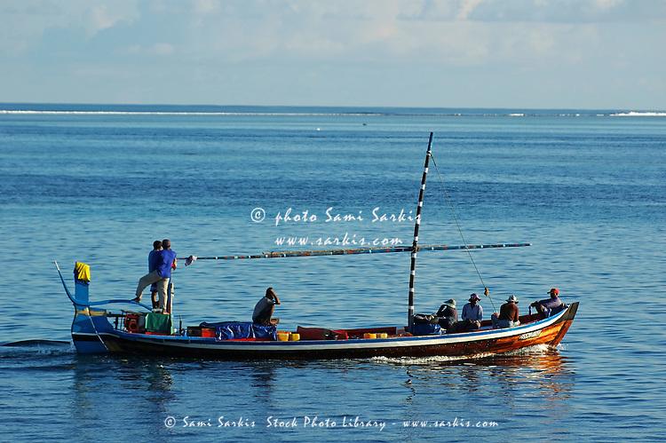 Fishermen on a traditional dhoni boat, Maldives.
