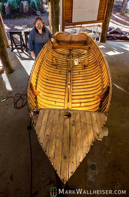 Adriene Hill works on an old boat at the Big Bend Maritime Center boat shop in Panacea, FL.