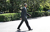 United States President Barack Obama walks across the driveway as he departs the White House in Washington, DC en route to Joint Base Andrews where he will fly to New Brunswick, New Jersey to deliver a commencement speech at Rutgers University on May 15, 2016.<br /> Credit: Dennis Brack / Pool via CNP