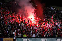 The Chicago Fire fans light a flare to celebrate Blanco's goal, which sent the Fire on to the next round.  The Chicago Fire defeated the New England Revolution 2-0 to win their playoff series at Toyota Park in Bridegview, IL on November 7, 2009.