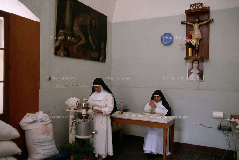 Nuns make wafers for communion at Santa Catalina Convent in Arequipa, Peru. The Monasterio de Santa Catalina was built in 1580 and enlarged in the 17th century. Among the 30 cloistered nuns who live in privacy in the convent.  Older nuns make  the wafers for communion. Seven times during the day they go to their chapel for chorus and pray.