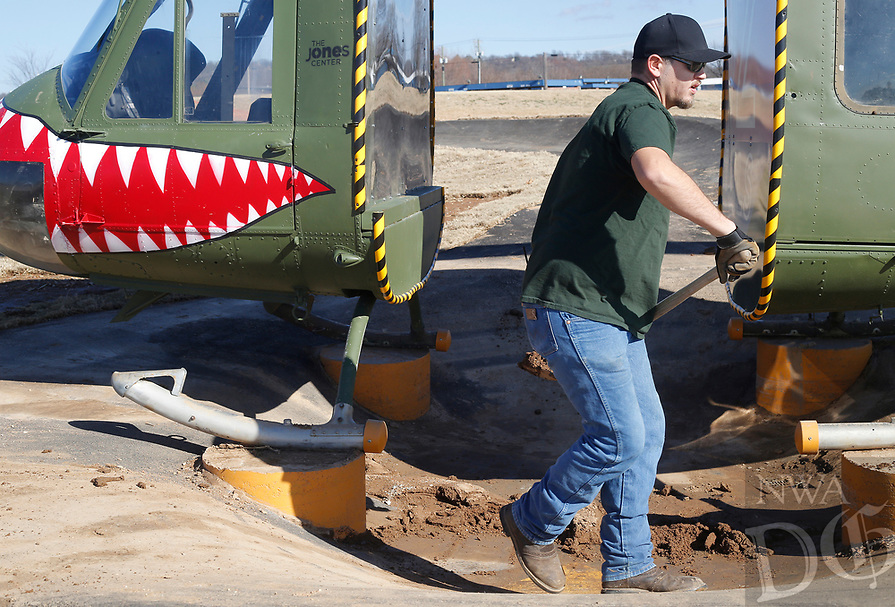 NWA Democrat-Gazette/DAVID GOTTSCHALK  Vance Parks, with Jones Trust Maintenance, shovels out dirt Monday, January 7, 2019, from under the helicopter feature at the Runway Bike Park at the Jones Center in Springdale. The Pump Track area and the Bicycle Play Ground is open but the Runway 95 area, that has the helicopter feature, remains closed as work continues.