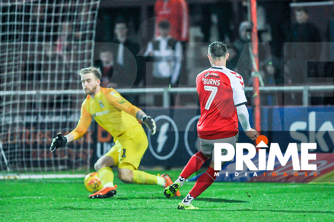Fleetwood Town's forward Wes Burns (7) puts it through Coventry City's goalkeeper Lee Burge (1) legs during the Sky Bet League 1 match between Fleetwood Town and Coventry City at Highbury Stadium, Fleetwood, England on 27 November 2018. Photo by Stephen Buckley / PRiME Media Images.