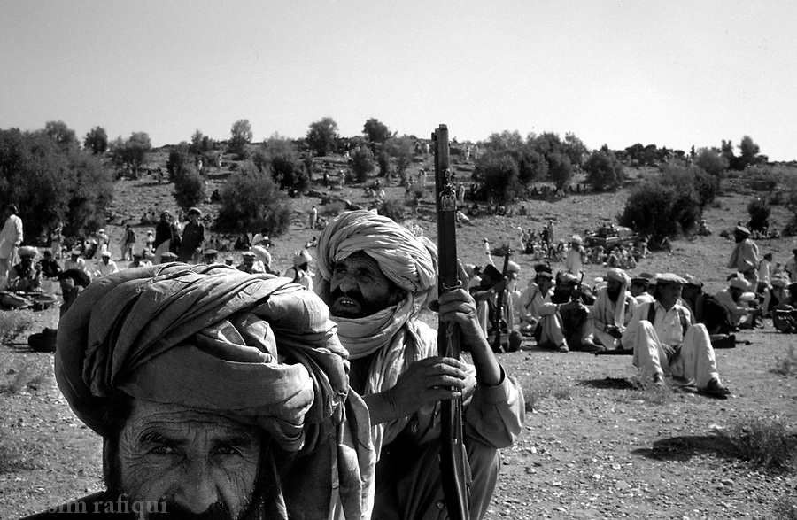 barwaiz raghzia hills, south waziristan, april 2004: deep in the south eastern mountains of south waziristan, a tribal lashkar gathers in preparation for a hunt of suspected al qaeda fighters and supporters.