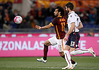 Calcio, Serie A: Roma vs Bologna. Roma, stadio Olimpico, 11 aprile 2016.<br /> Roma&rsquo;s Mohamed Salah, left, is chased by Bologna&rsquo;s Luca Rossettini during the Italian Serie A football match between Roma and Bologna at Rome's Olympic stadium, 11 April 2016.<br /> UPDATE IMAGES PRESS/Isabella Bonotto