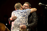 "© Joel Goodman - 07973 332324 . 05/02/2016 . Manchester , UK . NICKY LOCKETT ( MC Tunes ) and SHAUN RYDER hug on stage . "" Hacienda Classical "" debut at the Bridgewater Hall . The 70 piece Manchester Camerata and performers including New Order's Peter Hook , Shaun Ryder , Rowetta Idah , Bez and Hacienda DJs Graeme Park and Mike Pickering mixing live compositions . Photo credit : Joel Goodman"