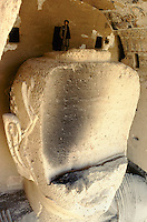 A local Taleban leader on the damage head of the 54 meters high Bamiyan Buddha, in 1999.These magnificent colossal statues, created during the 3rdâ4th centuries A.D., attracted pilgrims for centuries, far beyond the time when Buddhism languished in India following the disastrous visitation of the Hephthalite Huns in the 5th century, the subsequent resurgence of Hinduism, and the arrival of iconoclastic Islam in the 7th century.The entire niche was once covered with paintings dating from i he late 5th to the early 7th centuries.