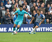 Tottenham Hotspur's Son Heung-Min (left) under pressure from Brighton & Hove Albion's Martin Montoya (right) <br /> <br /> Photographer David Horton/CameraSport<br /> <br /> The Premier League - Brighton and Hove Albion v Tottenham Hotspur - Saturday 5th October 2019 - The Amex Stadium - Brighton<br /> <br /> World Copyright © 2019 CameraSport. All rights reserved. 43 Linden Ave. Countesthorpe. Leicester. England. LE8 5PG - Tel: +44 (0) 116 277 4147 - admin@camerasport.com - www.camerasport.com