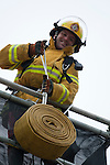 Vancouver, Canada, Aug 6th 2009.  World Police and Fire Games, Ultimate Firefighter Competition. Competitor William Meakin from Canadian National Defense-Fire pulls a 40-pound hose to the top of the tower in the Weight and Strength Stage of the competition.  Photo by Gus Curtis