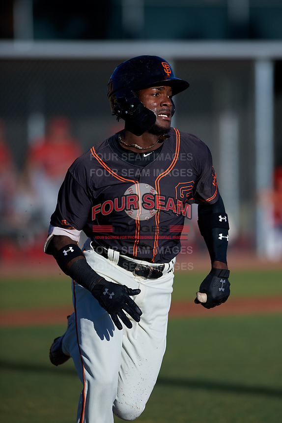 AZL Giants Black Ghordy Santos (8) runs to first base during an Arizona League game against the AZL Angels at the Giants Baseball Complex on June 21, 2019 in Scottsdale, Arizona. AZL Angels defeated AZL Giants Black 6-3. (Zachary Lucy/Four Seam Images)