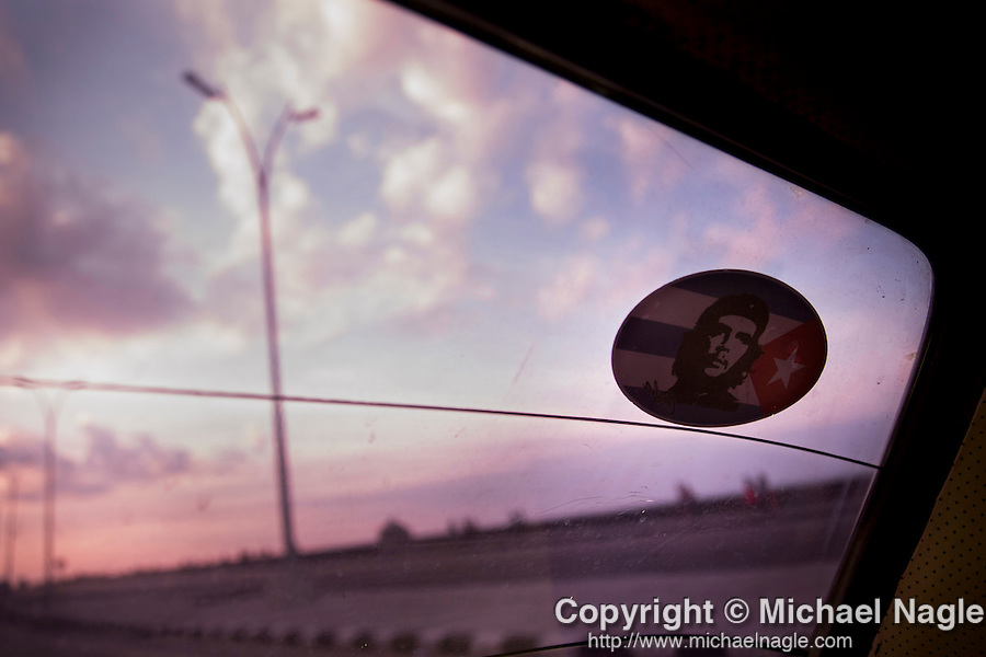 HAVANA, CUBA -- MARCH 23, 2015:  A Che Guevara sticker is displayed on a taxi traveling along the Malecon in Havana, Cuba on March 23, 2015. Photograph by Michael Nagle