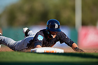 Detroit Tigers center fielder Daniel Woodrow (80) dives back to first base on a pick off attempt during a Grapefruit League Spring Training game against the Baltimore Orioles on March 3, 2019 at Ed Smith Stadium in Sarasota, Florida.  Baltimore defeated Detroit 7-5.  (Mike Janes/Four Seam Images)