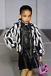 Model walks runway in for the 7th Golden Kids Runway fashion show at The Stewart Hotel in New York City, on March 11, 2018.