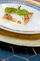 Detail of a Moroccan apple tart served with a fresh sprig of mint