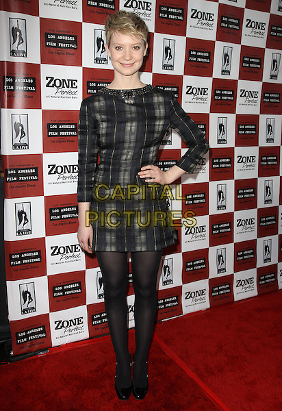 "MIA WASIKOWSKA.2010 Los Angeles Film Festival Opening night premiere ""The Kids Are All Right"" held at Regal Cinemas, Los Angeles, CA, USA..June 17th, 2010.full length black tights grey gray check long sleeved dress hand on hip.CAP/ADM/KB.©Kevan Brooks/AdMedia/Capital Pictures."
