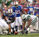 24 September 2006: New York Jets linebacker Victor Hobson (54) picks up a fumble against the Buffalo Bills at Ralph Wilson Stadium in Orchard Park, NY. The Jets defeated the Bills 28-20. Mandatory Photo Credit: Ed Wolfstein Photo