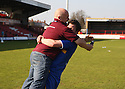 Scott Laird of Stevenage Borough and Steve Watkins celebrate promotion after the Blue Square Premier match between Kidderminster Harriers and Stevenage Borough at the Aggborough Stadium, Kidderminster on Saturday 17th April, 2010..© Kevin Coleman 2010