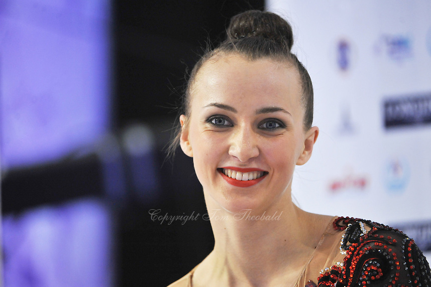 September 25, 2014 - Izmir, Turkey - ANNA RIZATDINOVA of Ukraine smiles from 'kiss & cry' during 2014 World Championships.