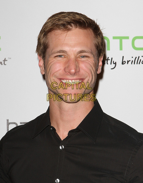 Jake Pavelka.The HTC Statusª Social Launch Event held at Paramount Studios in Hollywood, California, USA..July 19th, 2011.headshot portrait black smiling.CAP/ADM/KB.©Kevan Brooks/AdMedia/Capital Pictures.