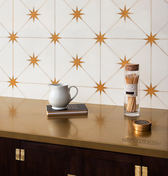 Orion, a waterjet stone mosaic, shown in polished Thassos and Xanadu, is part of the Trove® collection for New Ravenna.<br />