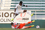 08 July 2015: Fort Lauderdale's Walter Ramirez (HON) (above) jumps over a tackle by Carolina's Wes Knight (below). The Carolina RailHawks hosted the Fort Lauderdale Strikers at WakeMed Stadium in Cary, North Carolina in a North American Soccer League 2015 Fall Season match. The game ended in a 1-1 tie.
