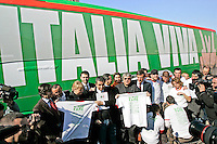 "Attivisti del Partito Democratico posano davanti al pullman che accompagnera' il leader e candidato premier Walter Veltroni nel suo tour elettorale in giro per l'Italia, davanti alla sede del partito a Roma, 15 febbraio 2008..Democratic Party's activists pose near the electoral campaign bus, in front of the party's headquarters in Rome, 15 february 2008. Writing on the bus reads: ""Italy Alive"" as a play on words on ""Viva L'Italia"" (Long Live Italy). Candidate premier Walter Veltroni will cover by the bus the Italian territory for his electoral tour. Political elections are scheduled on next 13 and 14 april..UPDATE IMAGES PRESS/Riccardo De Luca"