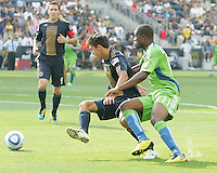 Stefani Miglioranzi #6 of the Philadelphia Union moves the ball away from Steve Zakuani #11 of the Seattle Sounders FC during the first MLS match at PPL stadium in Chester, PA. on June 27 2010. Union won 3-1.