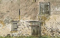 Old stone barn facade.