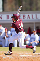 Rob Kral #14 of the College of Charleston Cougars follows through on his swing against the Davidson Wildcats at Wilson Field on March 12, 2011 in Davidson, North Carolina.  The Wildcats defeated the Cougars 8-3.  Photo by Brian Westerholt / Four Seam Images