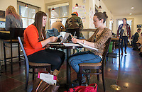 Occidental College students, from left, Jessica May '15 and Lauren Rewers '16, study for finals on Dec. 11, 2013 in The Green Bean Coffee Lounge. (Photo by Marc Campos, Occidental College Photographer)