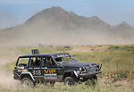 Nate Oyler works his way around the course at the beginning of the Buffalo Chip 100 off-road racing event Saturday at the T.O.R.C. track in Sturgis, S.D. Bear Butte served as a backdrop for the event. (Photo by Richard Carlson/Inertia)