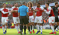 The Arsenal players surround referee Kevin Friend after a clash between Burnley's Ashley Barnes & Arsenal's Sokratis Papastathopoulos<br /> <br /> Photographer David Shipman/CameraSport<br /> <br /> The Premier League - Arsenal v Burnley - Saturday 22nd December 2018 - The Emirates - London<br /> <br /> World Copyright © 2018 CameraSport. All rights reserved. 43 Linden Ave. Countesthorpe. Leicester. England. LE8 5PG - Tel: +44 (0) 116 277 4147 - admin@camerasport.com - www.camerasport.com