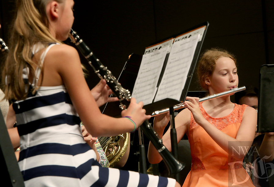 NWA Democrat-Gazette/DAVID GOTTSCHALK  Camille Wright, of Fayetteville, plays with the Hogwild Band Friday, July 14, 2017, during the 60th Junior High Band Camp Final Concerts at the Fayetteville High School Performing Arts Center. More than 1,000 student musicians will participate in the 60th annual University of Arkansas Summer Music Camp over the two week period from July 9 - 21.  Summer Music Camp is an annual program of the Department of Music's Community Music School.