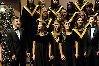 STAFF PHOTO FLIP PUTTHOFF <br /> NOEL, NOEL IN CHORUS<br /> Bentonville High School choral students sing during a performance of their Christmas program, Noel, on Saturday Dec. 6 2014 at the Arend Arts center on the high school campus. Students from the school's various choral groups put on two performances Saturday at the center. The show featured traditional Christmas carols and lesser known holiday songs.