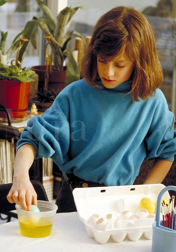 Girl painting Easter eggs. Family. Douglaston NY.