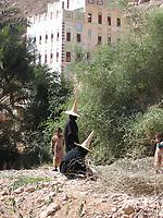 Wadi Hadhramaut, Hadhramaut Governorate, Yemen:  - abaya and madhalla conical hat - niqab dress