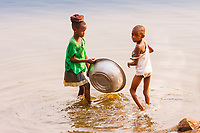 Africa, Ghana, black children wash in the river