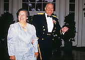 General H. Norman Schwarzkopf and his wife, Brenda, arrive at the White House in Washington, D.C. for a State Dinner in honor of Queen Elizabeth II of Great Britain on May 14, 1991.  Schwarzkopf passed away in Tampa, Florida on Thursday, December 27, 2012..Credit: Ron Sachs / CNP