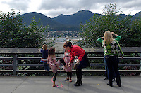 USA. Juneau.13th September 2007.On her way from the Governors Mansion to her office in the State Capitol, Sarah Palin stops to attend to her daughter Piper. .©Andrew Testa/Panos