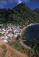 AJ2495, Dominica, Caribbean, Caribbean Islands, Aerial view of beachfront houses and and scenic hillsides in Soufriere on the island of Dominica.