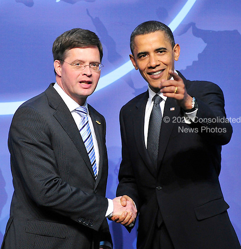United States President Barack Obama welcomes Prime Minister Dr. Jan Peter Balkenende of the Netherlands to the Nuclear Security Summit at the Washington Convention Center, Monday, April 12, 2010 in Washington, DC. .Credit: Ron Sachs / Pool via CNP
