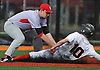 David Falco #11, Center Moriches third baseman, left, tags out Joe Rende #10 on a successful pickoff attempt in the bottom of the first inning of a Suffolk County varsity baseball game at Babylon High School on Monday, April 17, 2017. Center Moriches won by a score of 3-1.