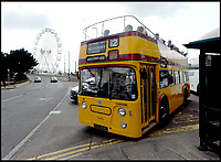 BNPS.co.uk (01202 558833)<br /> Pic: RogerArbon/BNPS <br /> <br /> The vintage bus near Bournemouth pier.<br /> <br /> A small group of volunteers have reintroduced a historic seaside bus service after spending five years restoring the original bus that travelled the route 50 years ago.<br /> <br /> The classic yellow open top 1965 Daimler Fleetline double decker is back running the old 'Route 12'  service between Bournemouth and Hengistbury Head.<br /> <br /> The volunteers drive and conduct the bus, as well as maintaining it and producing the timetables and bus stop flags.<br /> <br /> The vintage Bournemouth Corporation Transport bus ran along the idyllic five mile stretch of Dorset coastline from 1965 to 1977.<br /> <br /> But it had fallen into a 'sorry state' and was languishing in a depot when it was purchased by the volunteers from a bus operator in Purfleet, Essex, for £2,000 in 2014.