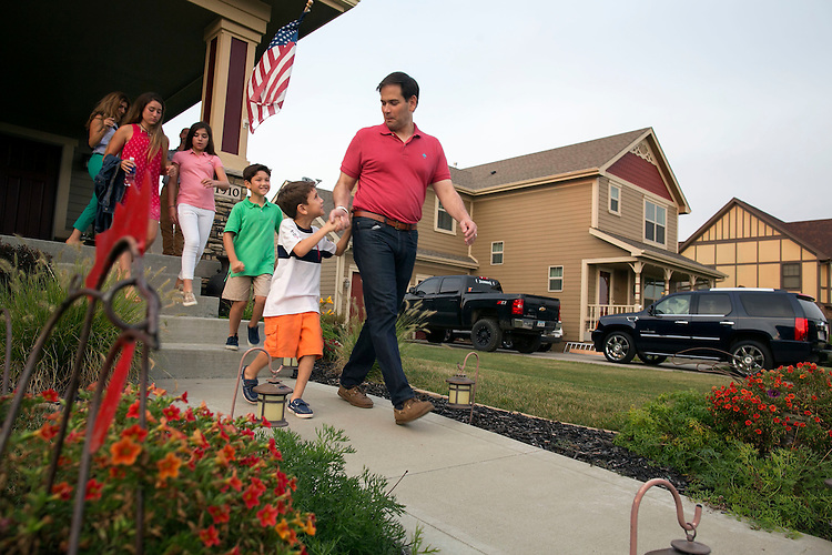 UNITED STATES - August 17: Republican presidential candidate Sen. Marco Rubio, R-Fla., holds hands with his son, Anthony, as he leaves the porch of Steve and Donna Shelley while campaigning in Ankeny, Iowa, Monday, August 17, 2015. Behind Rubio and his son is from right, son Dominick, daughters Daniella and Amanda, and wife Jeanette Dousdebes Rubio. (Photo By Al Drago/CQ Roll Call)