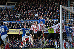 "Portsmouth 1 Southampton 1, 18/12/2012. Fratton Park, Championship. Fans in the South Stand watching the action as Portsmouth striker Dave Kitson leaps above Southampton goalkeeper Kelvin Davis during the second half of their Championship fixture at Fratton Park stadium, Portsmouth. Around 3000 away fans were taken directly to the game in a fleet of buses in a police operation known as the ""coach bubble"" to avoid the possibility of disorder between rival fans. The match ended in a one-all draw watched by a near capacity crowd of 19,879. Photo by Colin McPherson."