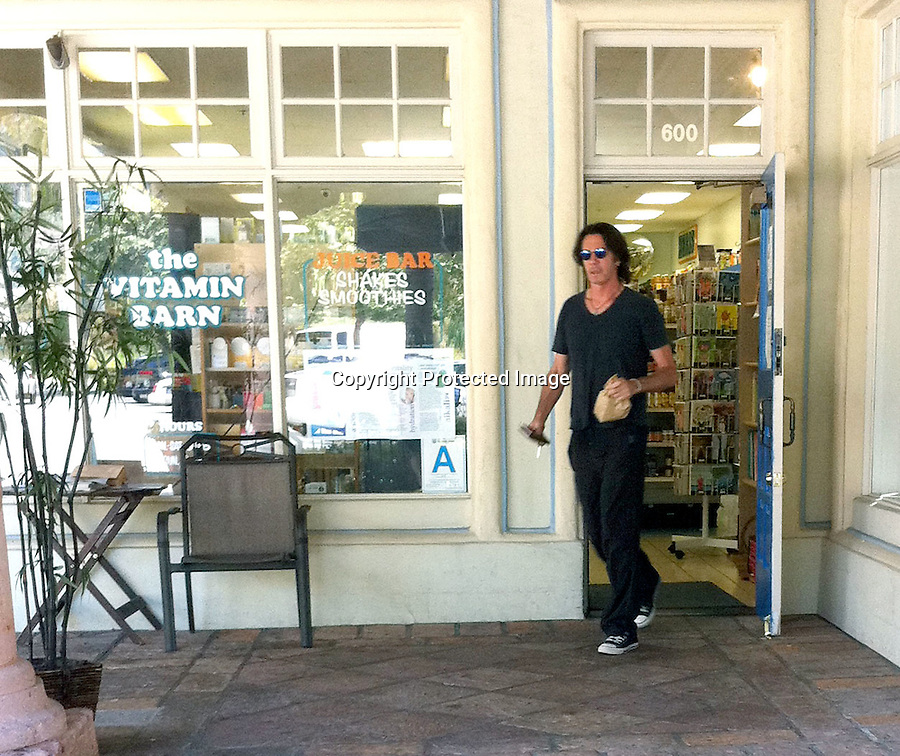August 17th 2010..Rick Springfield picking up some Vitamins at a store in Malibu California. Rick loves dogs & had to stop & pet one as he left. ...AbilityFilms@yahoo.com.805-427-3519.www.AbilityFilms.com.