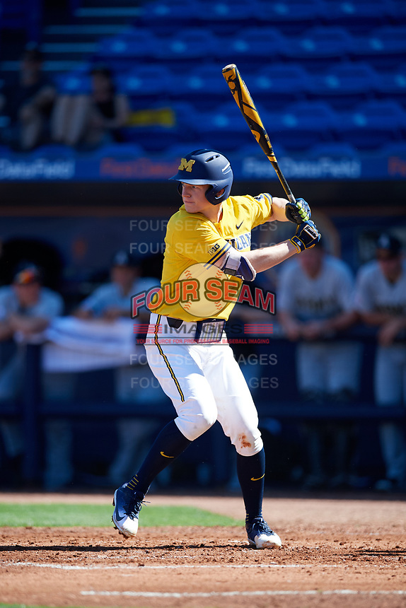 Michigan Wolverines third baseman Jimmy Kerr (15) at bat during a game against Army West Point on February 17, 2018 at Tradition Field in St. Lucie, Florida.  Army defeated Michigan 4-3.  (Mike Janes/Four Seam Images)