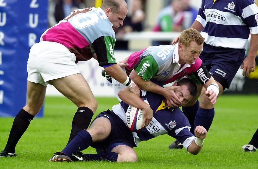 Photo. Richard Lane. .Harlequins v Bristol. Zurich Premiership. 16/9/2000.Steven Vile is brought down by Peter Richards and Paul Burke.